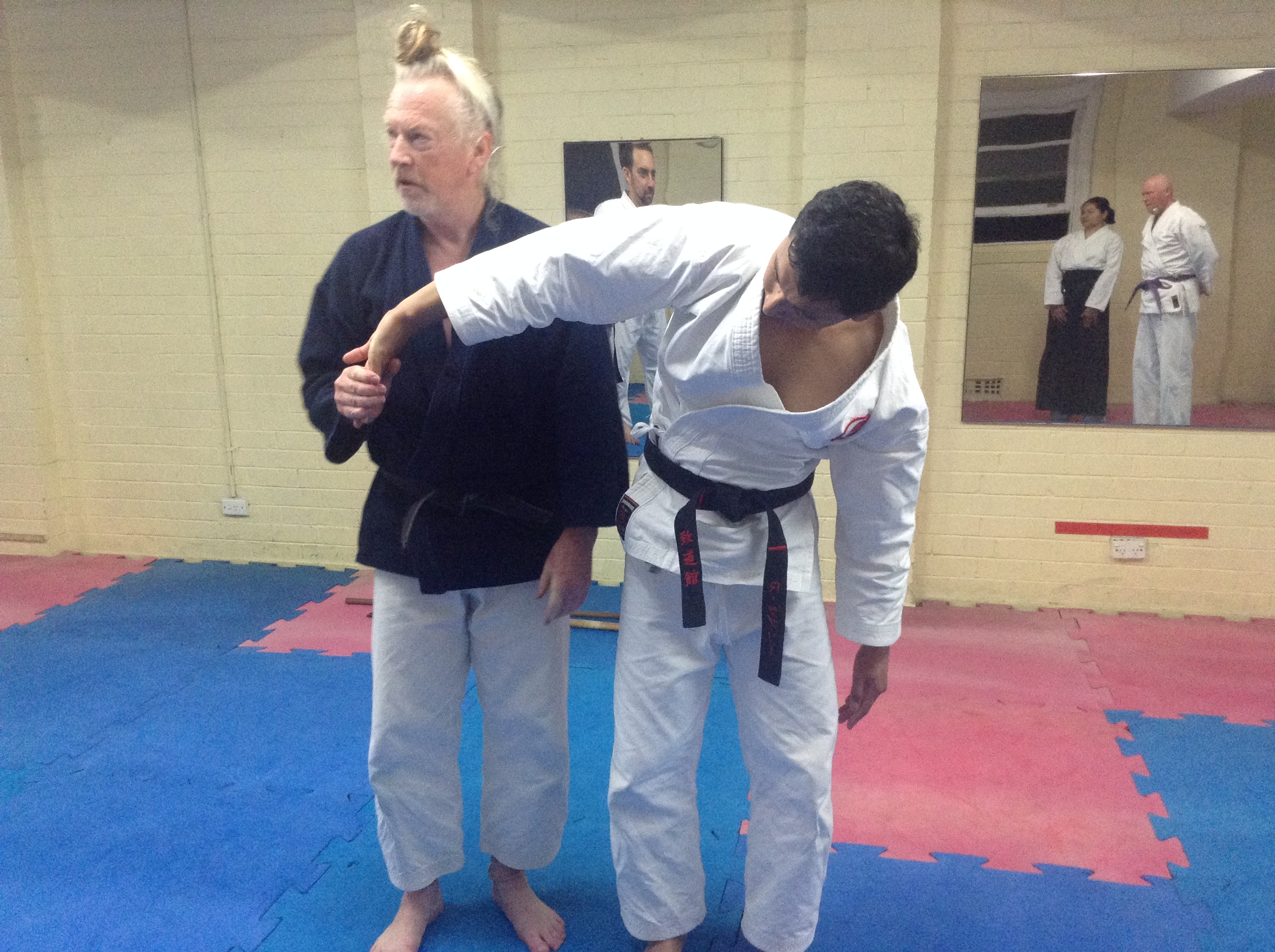 Sensei Robertson deals with a lapel grab from Riz